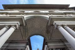 Massive columns and arches of the Uffizi Gallery in Florence, It. Uffizi Gallery in Florence under a blue sky with clouds, Florence, Tuscany, Italy Stock Images