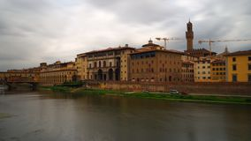 Uffizi Gallery, Florence. View of the museum entrance on the bank of the Arno river. The autumn sky is leaden and very dark Stock Images