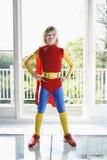Ufna chłopiec W bohatera kostiumu Indoors Fotografia Royalty Free