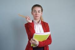 Ufna kobieta, biznesmen w czerwonej kurtce Fotografia Stock