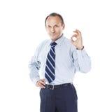 Ufny biznesmen gestykuluje sukcesu znaka Fotografia odizolowywająca na biały tle Fotografia Stock