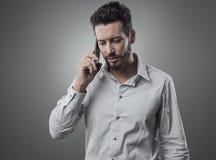 Ufny biznesmen na telefonie Obrazy Royalty Free