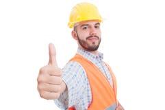 Ufny i pomyślny budowniczy pokazuje jak zdjęcia stock