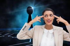 Ufny młody bizneswoman wskazuje jej głowę z ona palce Zdjęcia Stock