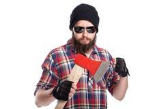 Ufny młody brodaty mężczyzna trzyma cioskę Zdjęcia Royalty Free