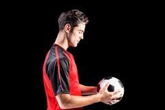 Ufny męski atlety mienia futbol Zdjęcie Royalty Free