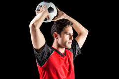 Ufny męski atlety miotania futbol Zdjęcie Stock