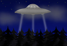 UFO. Unknown flying object above the night wood Royalty Free Stock Photo