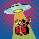 UFO abducts gift box Royalty Free Stock Image