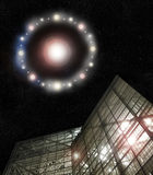 UFO above building. Huge glowing UFO hovering over a modern metal and glass building with star filled night sky Royalty Free Stock Image