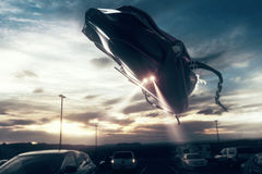 UFO above road with traffic Royalty Free Stock Image