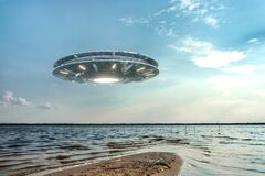 UFO, an alien plate hovering above water, hovering motionless in the air. Unidentified flying object, alien invasion,