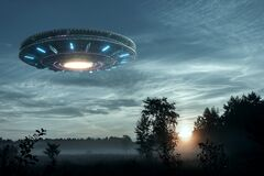 UFO, an alien plate hovering over the field, hovering motionless in the air. Unidentified flying object, alien invasion,