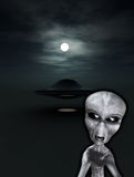 UFO With Angry Alien. An angry looking alien with a UFO in the background Stock Photography