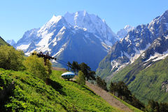 UFO in Caucasus mountains Dombai. Image of beautiful landscape with Caucasus mountains Stock Photo