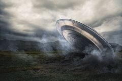UFO crashing on a crop field Stock Images