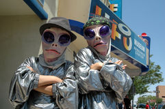 Ufo festival. Two aliens pose for a photograph at the entrance of the International UFO Museum and Research Center in Roswell, New Mexico during the UFO Festival Royalty Free Stock Photos