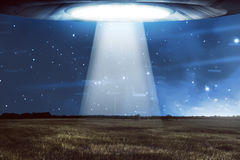UFO flying in a dark sky Royalty Free Stock Photo
