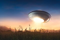 UFO with abduction beam flying in the sky
