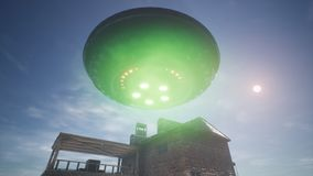UFO is flying over the house in the desert. 3D Rendering. royalty free stock images