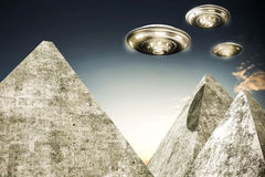 Ufo flying over pyramids Royalty Free Stock Photo