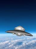 UFO Flying Saucer Above Earth Stock Image