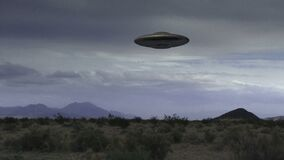 UFO 008: A Flying Saucer Hovers Over A Desert