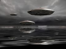 UFO. Flying saucers over the ocean. 3D rendering Royalty Free Stock Images