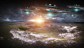 UFO invasion on planet earth landascape 3D rendering Royalty Free Stock Photo