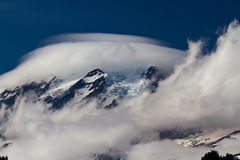 UFO-Looking Lenticular Clouds on Mount Rainier Stock Photos