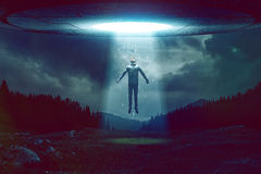 UFO. Man is beamed into the ufo Stock Image