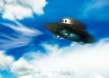 UFO moving in cloudy sky Stock Photography