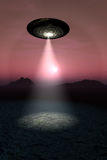 UFO over Desert Sunset Stock Images
