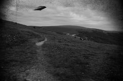 Ufo over the fields. Image similar to some old black and white pictures with UFO flying over fields Stock Photography