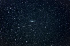 UFO passing the Andromeda galaxy stock images