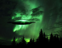 UFO rising out of the clouds Stock Photography