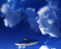 UFO In Sky. A UFO flying in the daylight sky amongst the clouds. Their are a few stars showing through as the UFO is high in the atmosphere Royalty Free Stock Photography