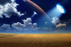 UFO in sky Stock Images