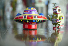Ufo toy. Ufo and little robot on old wooden floor Stock Photos