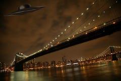 UFO under Manhattan. And Brooklyn bridge royalty free stock image