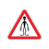 UFO Warning sign red. Alien Hazard attention symbol. Danger road Stock Images