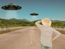 UFOs, alien invasion. Slight filter for retro effect.