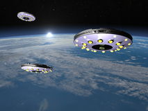 UFOs upon earth - 3D render Royalty Free Stock Photography