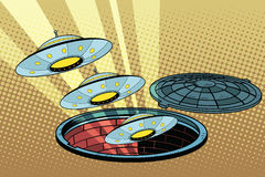 UFOs fly out of the sewers Stock Photo