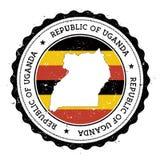 Uganda översikt och flagga i den rubber stämpeln för tappning av Royaltyfri Fotografi