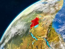Uganda on Earth with borders. Uganda on realistic model of planet Earth with country borders and very detailed planet surface and clouds. 3D illustration royalty free stock image