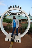 The Uganda Equator. A Uganda man is excited to be at the site that marks the equator in Uganda. This is a popular tourist attraction in the small East African Royalty Free Stock Photography