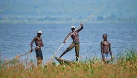 Uganda. Fishermen from the village fishing on the White Nile. MURCHISON FALLS, WHITE NILE RIVER, UGANDA – JUNE 11, 2012: Murchison Falls. White Nile River Stock Photo