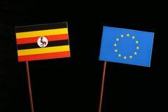 Uganda flag with European Union EU flag  on black Royalty Free Stock Photo