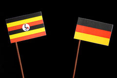 Uganda flag with German flag  on black Stock Photos